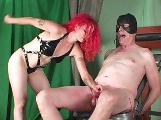 Redhead ballbusting mistress slaps balls