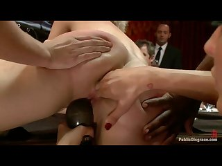 Submissive nude waitress serves the dinner