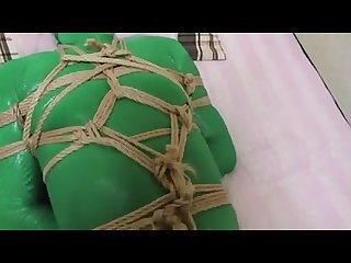 Kigurumi plays with zentai in bondage
