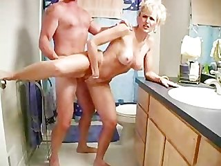 Hot milf or wife having a bathroom quickie