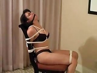 Hottie bound and gagged to a chair