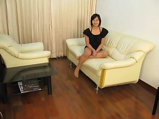 Young cute ladyboy masturbating on the couch