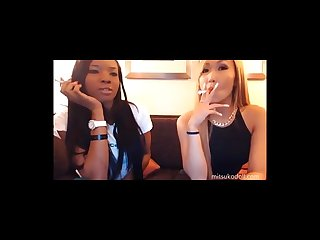 Ebony and asian girl smoking newports