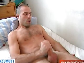 Huge cock of a swimmer guy gets wanked despite of him