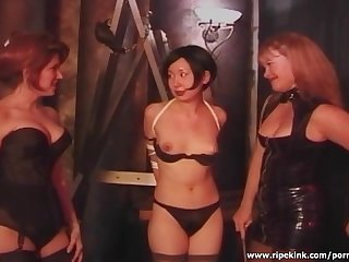 Two dominas having fun with slutty asian chick