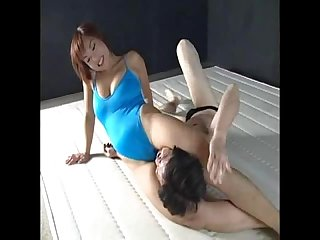 Strong asian woman dominates a wimp
