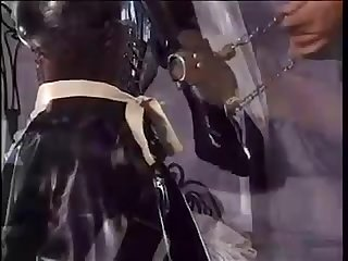 Latex maid bondage