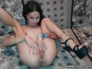 Skinny brunette plays with her pussy on webcam
