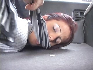 Hot redhead hogtied and gagged in the trunk