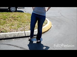 Wetting jeans in a parking lot