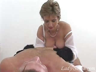 Gorgeous lady sonia in fur gloves jerks off dick slave