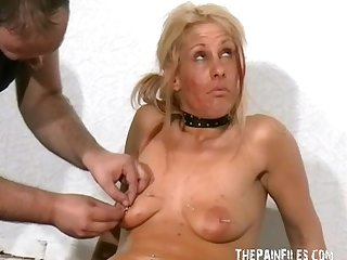 Needle bdsm and extreme Piercing of blonde female slave in suffering