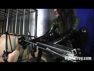 Latex mistress fucks slaves ass with machine then strapon