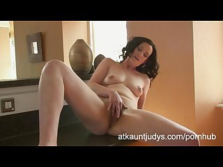 Emily marshall gets randy in the kitchen and rubs her mature pussy