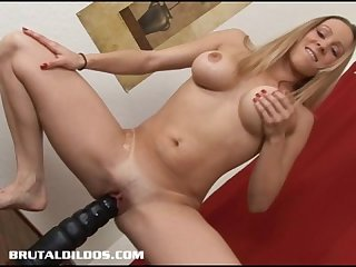 Leggy blonde cums from riding a massive brutal dildo