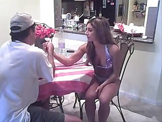 Buff young bikini girl armwrestles a man