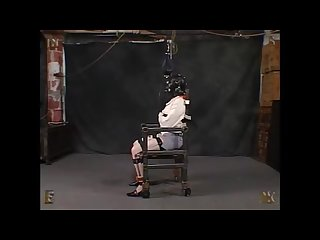 Straitjacket chair scene