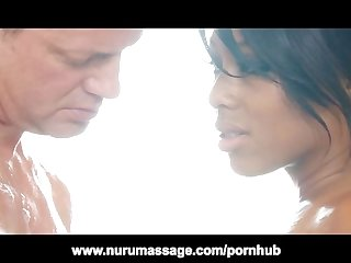Tattooed ebony interracial nuru massage doggystyle