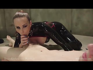 Latex dominatrix milks slave boy