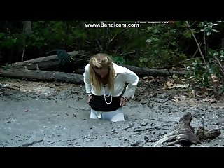 Blonde movie star tries to find her phone ends up sinking in quicksand