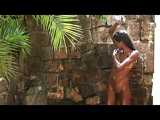 Valerie from hegre art showers outdoors and shaves her pussy