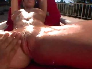 Hot tanning babe gets oiled up and rubbed