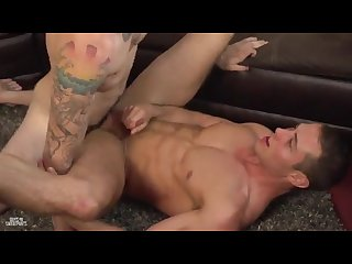 Hot stud fucked by tattooed guy