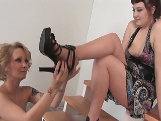 Mistress eris and her naked female foot slave