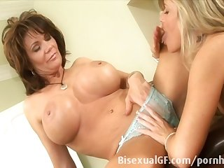 Two housewifes having sex on the bed