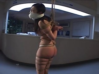 Tight bondage and gagged japanese being spanking