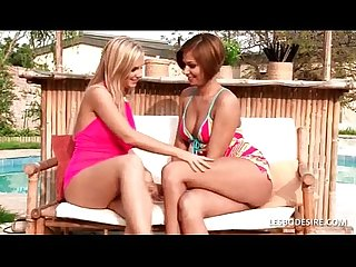 Amateur lesbians embrace and make out passionately by the pool