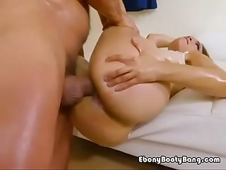 Oiled up Ebony fucked hard doggystyle