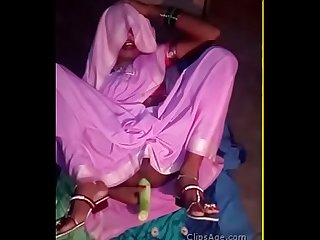 Desi vegetable vendor lady using a long vegetable to masturbate