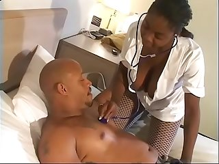 Black nurse Brown Sugar in fishnets enjoys her wet cunt penetrated deep by a huge pole