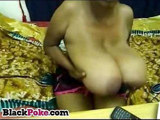 Black babe with massive boobs teasing on webcam