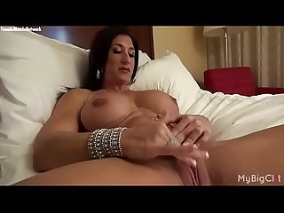Nude female bodybuilder rubs her big clit