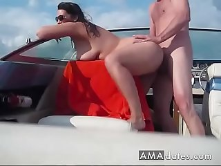 Nudist mature couple having sex on the boat