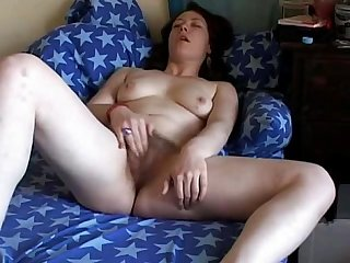 Fat chubby friend masturbating her hairy pussy and having an orgasm on the couch