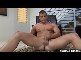 Muscular college hunk tugging on his rock hard cock