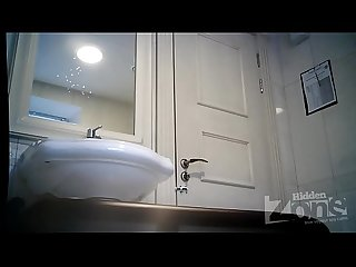 Spy cam in women's toilet - Blonde in black panties