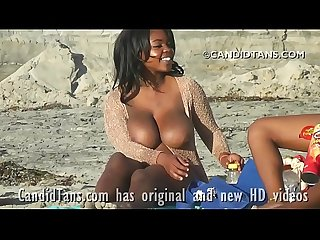 Ebony beauty with real HUGE natural boobs on the beach going topless!