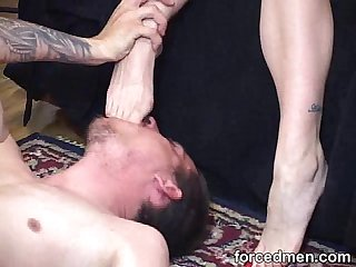 Naked man licks and worships his tired mistress' feet