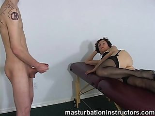 Oldie mistress spreads her legs to tease a young naked masturbating man