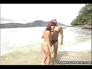 Redhead Tranny In Bikini Gets Rammed On A Beach