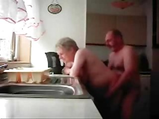 Lol mum and daddy caught having fun in the kitchen hidden cam