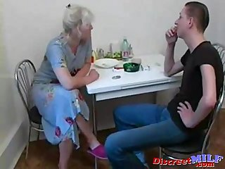Grandson fucks his old granny in the kitchen