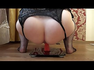 Mature bbw masturbates with a rubber dick in a cowgirl pose, appetizing booty shaking.