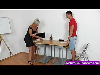 Blond haired madam giving a blowjob
