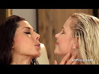 Pissing lesbians playful girls dive into their piss puddle