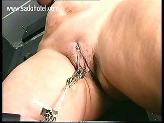 Older slave with big tits got metal clamps with lots of weight on it on her pussy in master